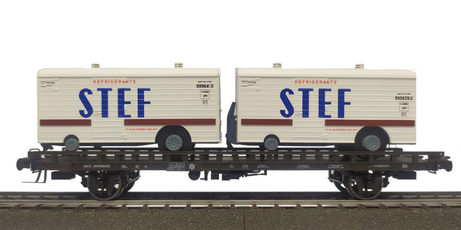 REWB636 Double carrier wagon loaded with refrigerated trailer of the SNCF