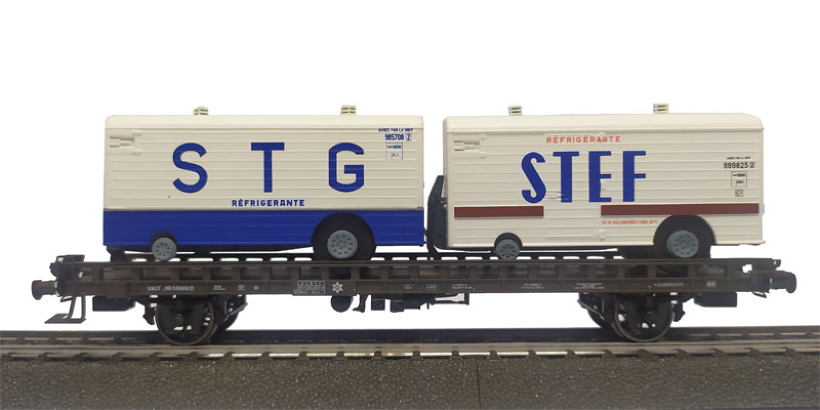 REWB635 Double carrier wagon loaded with refrigerated trailer of the SNCF